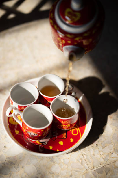 Tea pouring during Chinese wedding tea ceremony Tea pouring during Chinese wedding tea ceremony chinese wedding dinner stock pictures, royalty-free photos & images