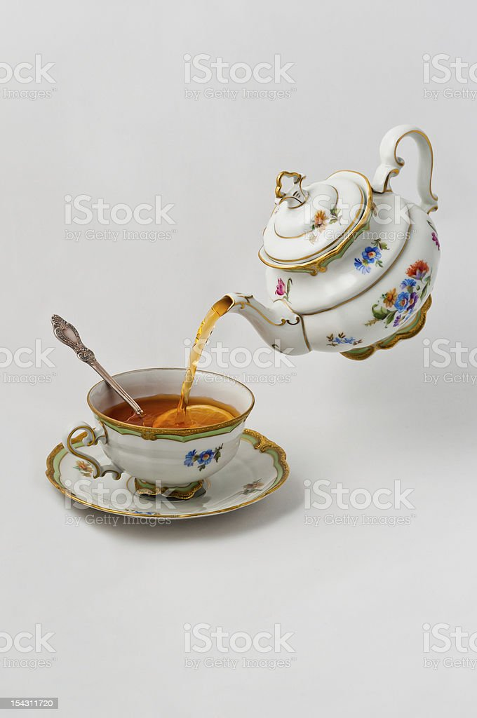 Tea pours into a cup royalty-free stock photo