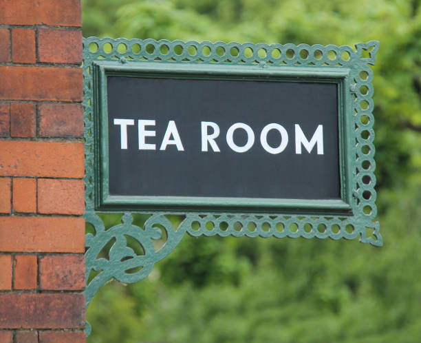 Tea Room Sign. A Vintage Cast Iron Railway Platform Tea Room Sign. tea room stock pictures, royalty-free photos & images