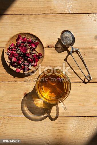 Tea rose flowers on wood
