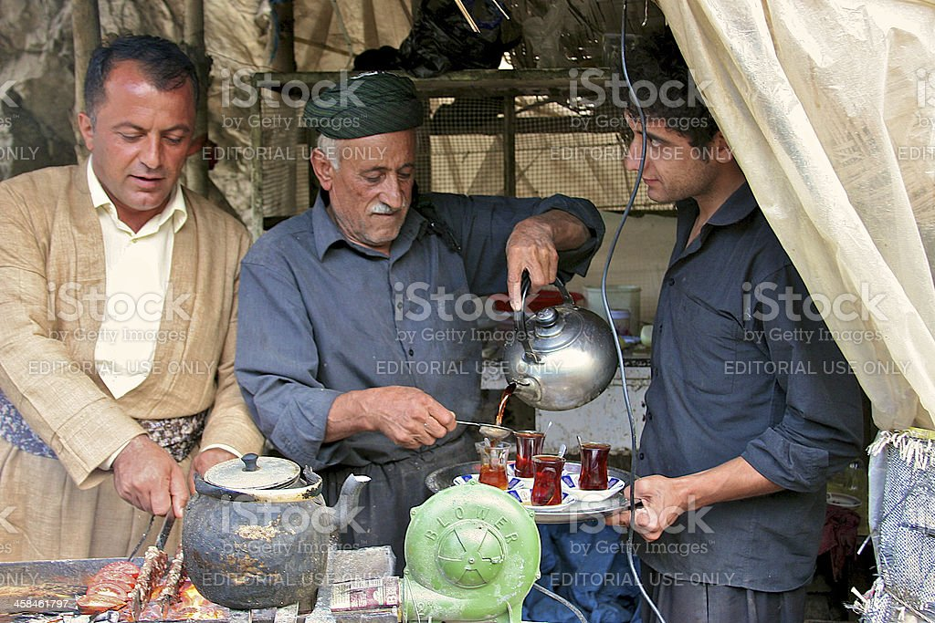 Tea serving and kebab roasting in small shack by road. royalty-free stock photo