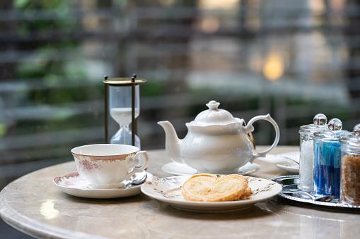 Tea set and palmier, food background.