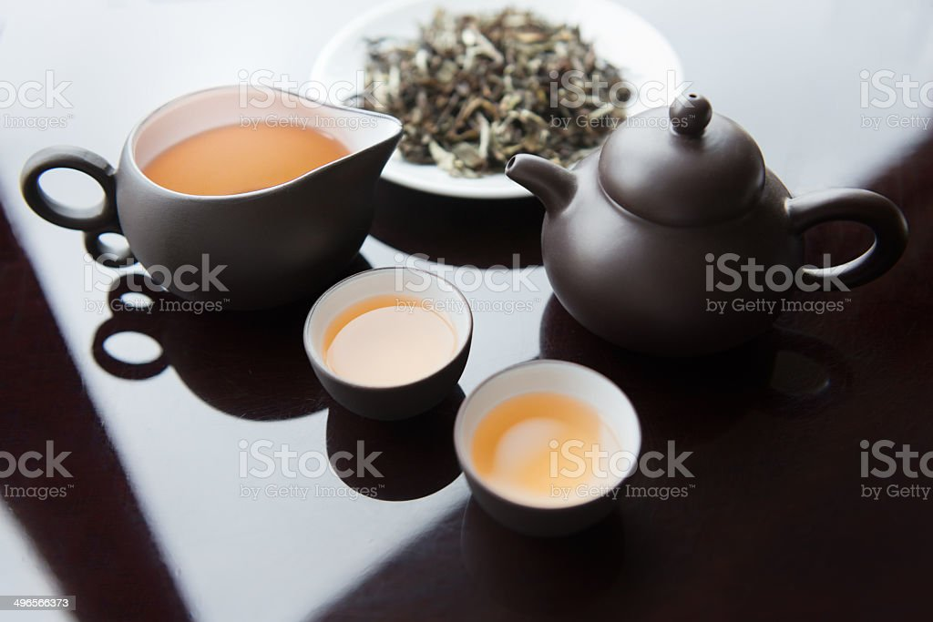 Tea Set and White Tea Leaves stock photo