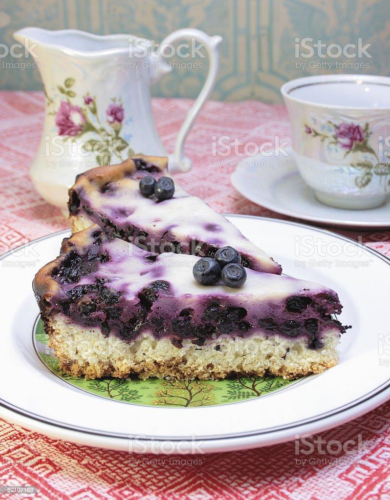 Tea Set with Blueberry Cream Flan royalty-free stock photo