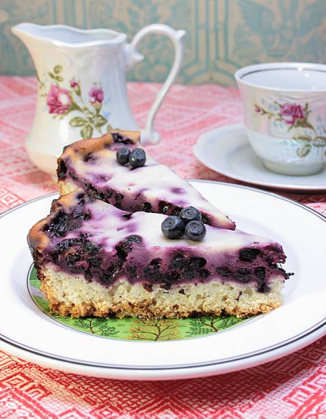 Tea Set with Blueberry Cream Flan stock photo