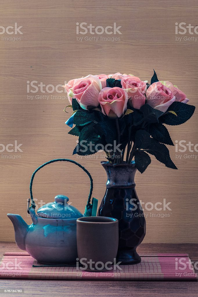 Tea set with pink rose concept relax and meditation stock photo