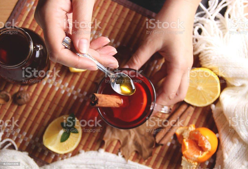 Tea spoon of honey stock photo