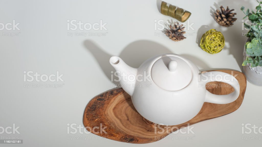 Tea time, and tea drinking. White porcelain teapot with accessories...