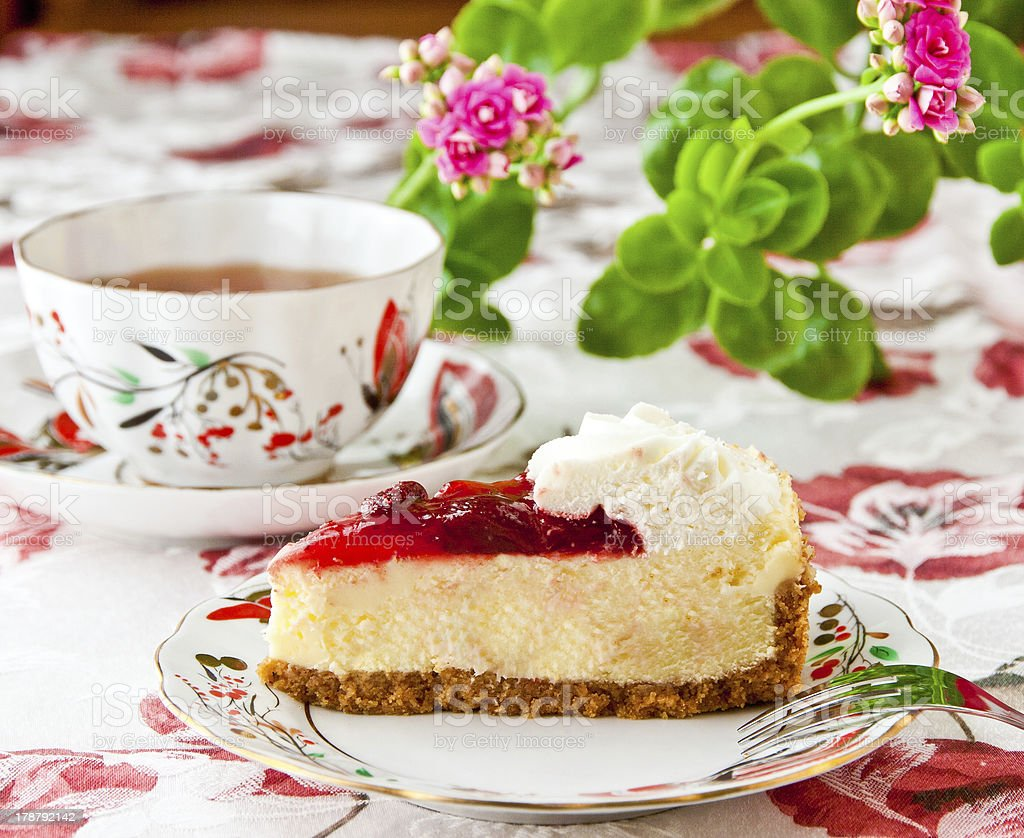 Tea time. Strawberry cheesecake and cup of tea. selective focus royalty-free stock photo