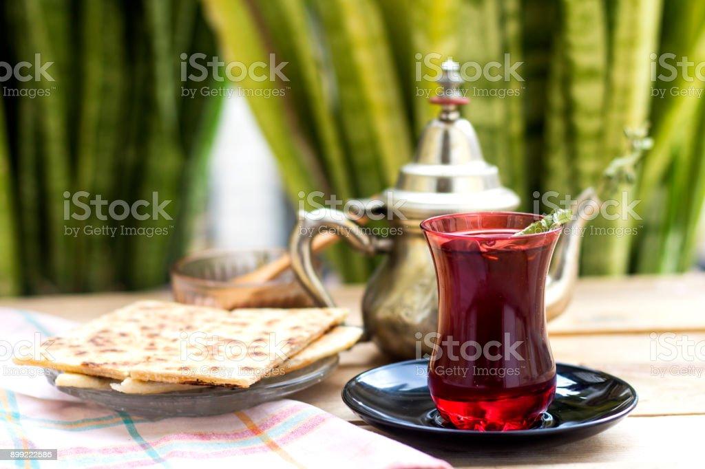 tea time, turkish tea and pie arabic with honey stock photo