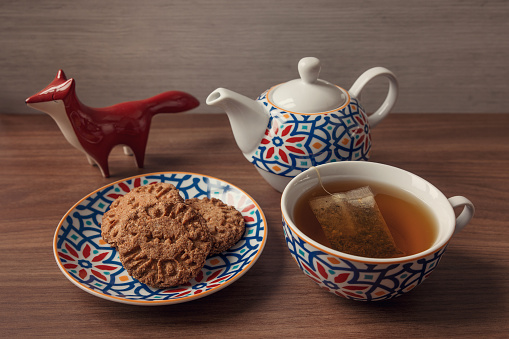 Tea time with homemade biscuits - Tea set with colorful geometric patterns