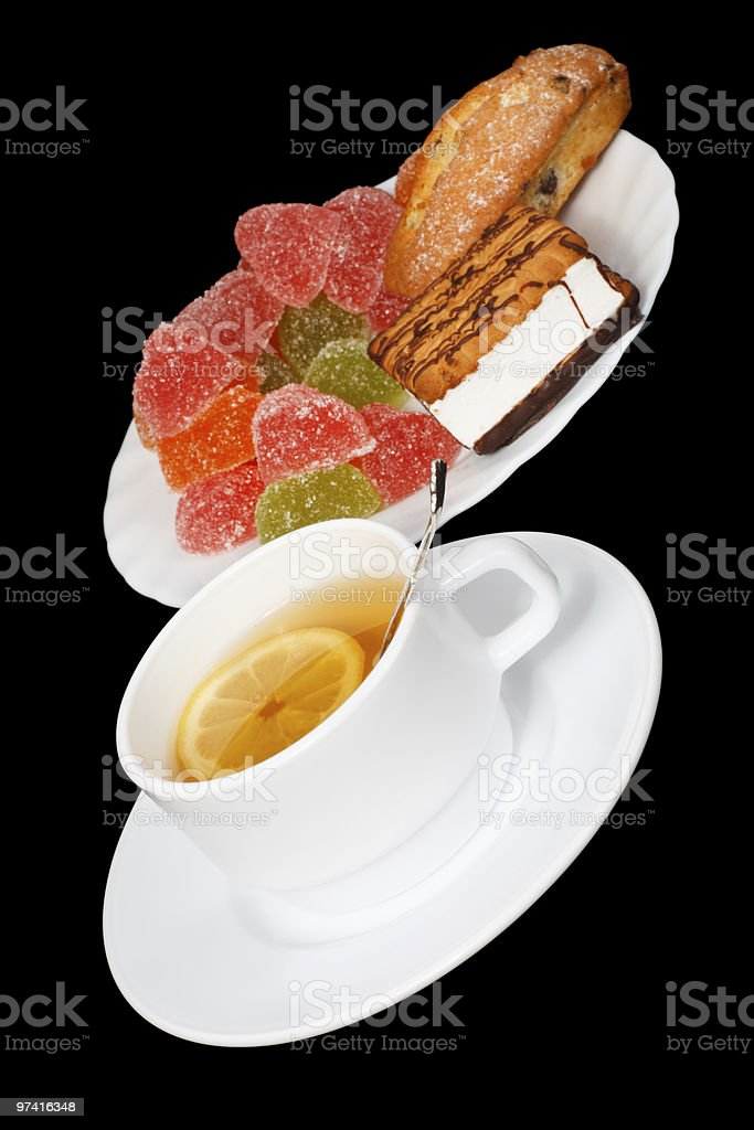 Tea with a lemon and sweets royalty-free stock photo