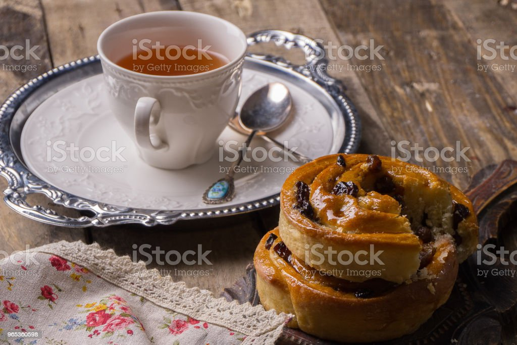 Tea with cinnamon Buns and raisin royalty-free stock photo
