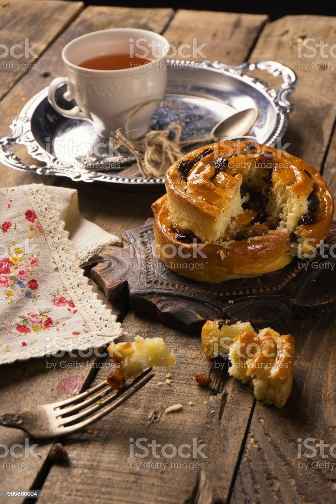 Tea with cinnamon Buns and raisin royalty-free stock photo