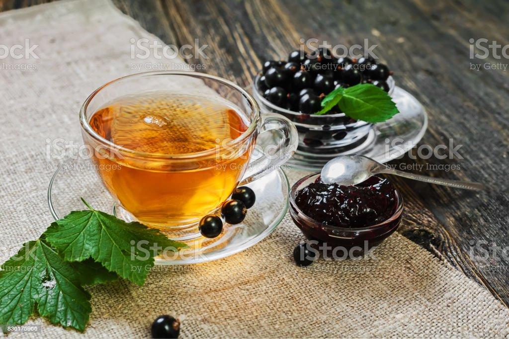 Tea with currant jam stock photo