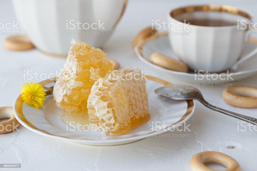 Tea with honey on white background ロイヤリティフリーストックフォト