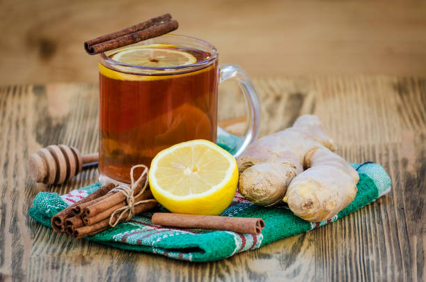 tea with lemon and ginger tea with lemon and ginger, cinnamon and honey ginger spice stock pictures, royalty-free photos & images