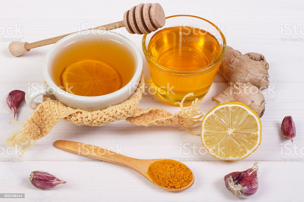 Tea with lemon and ingredients for preparation warming beverage stock photo
