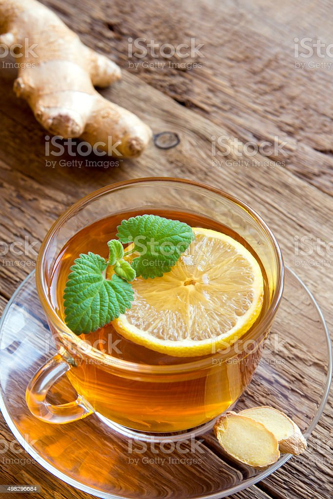 Tea with lemon, ginger and mint stock photo