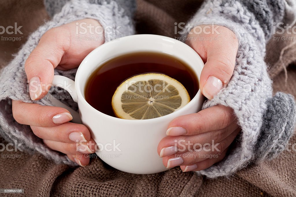 Tea with lemon on a cold day stock photo