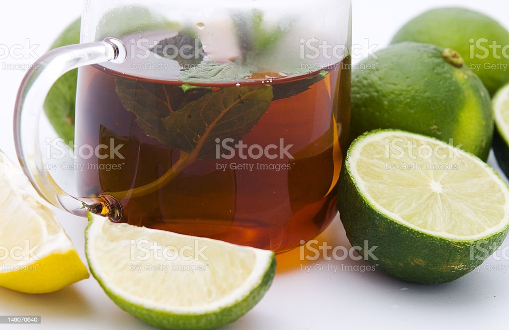 Tea with mint and limes royalty-free stock photo