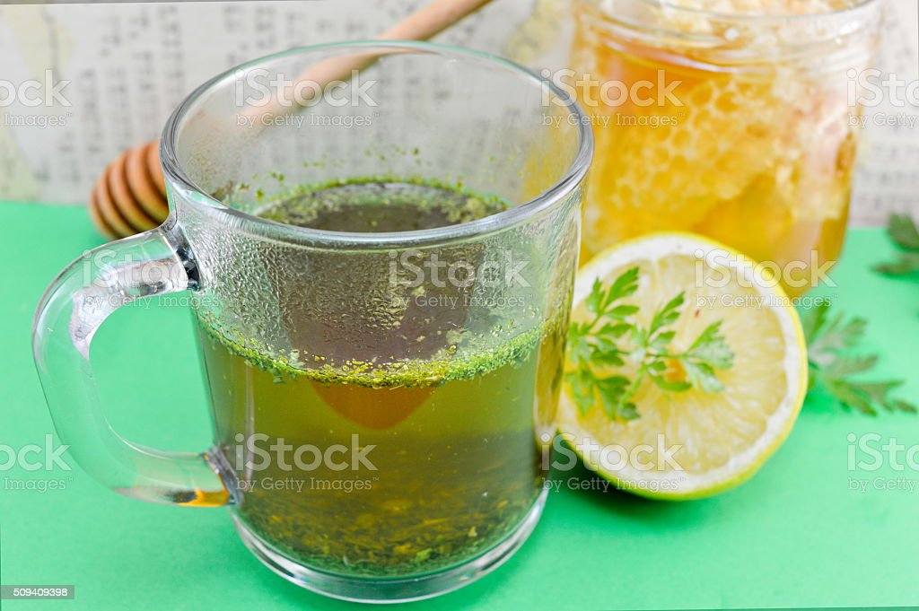 Tea with parsley, lemon and honey royalty-free stock photo