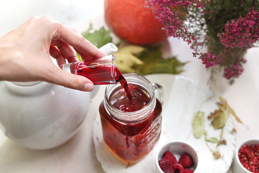 istock Tea with raspberry juice. Home remedies for colds. 1055479838