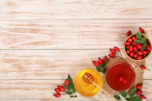 Tea with rose hips and honey on white wooden background with copy picture id859347290?b=1&k=6&m=859347290&s=612x612&w=0&h=yhp52mtikgzmkpky rwud35batag9fjdugvh6jwzu5a=