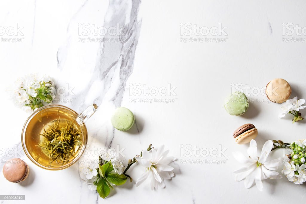 Tea with spring flowers stock photo