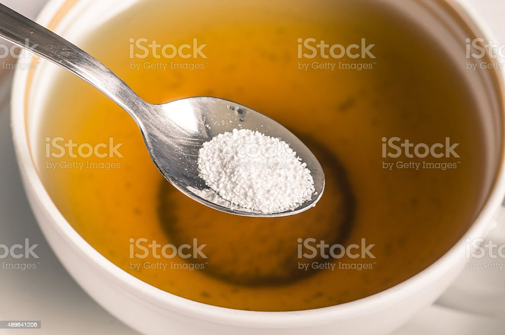 Tea with sweetener in a spoon stock photo