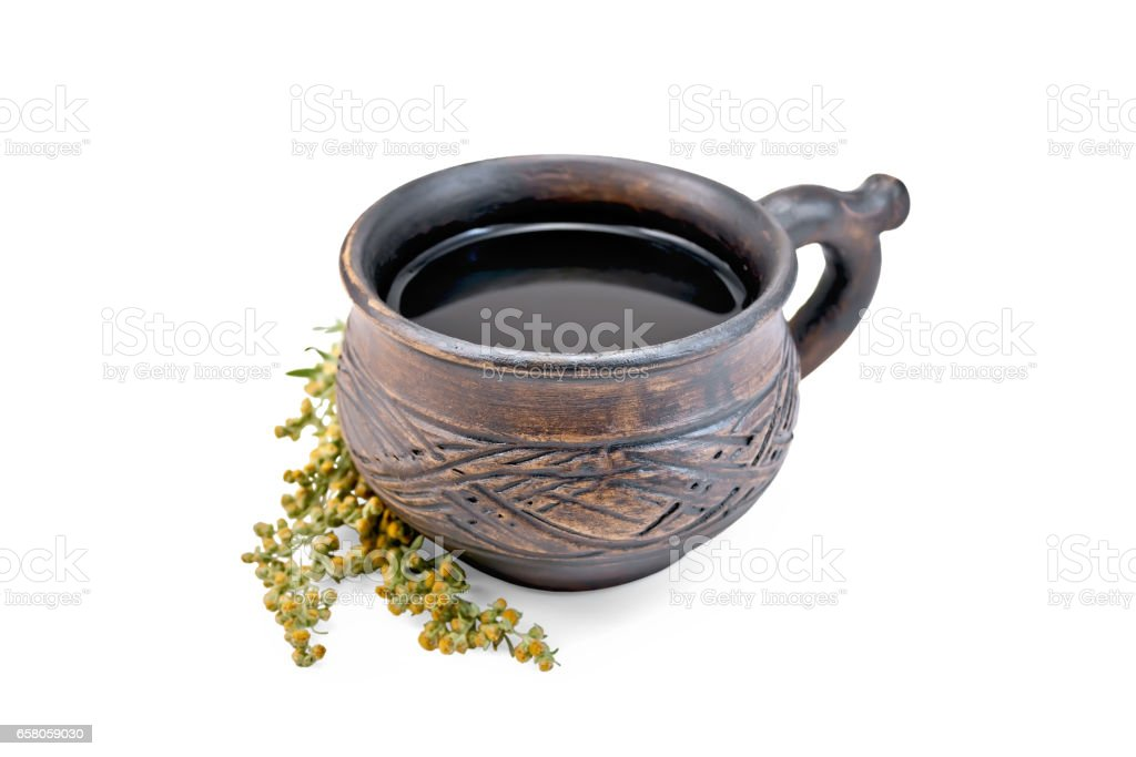 Tea with wormwood in clay cup royalty-free stock photo