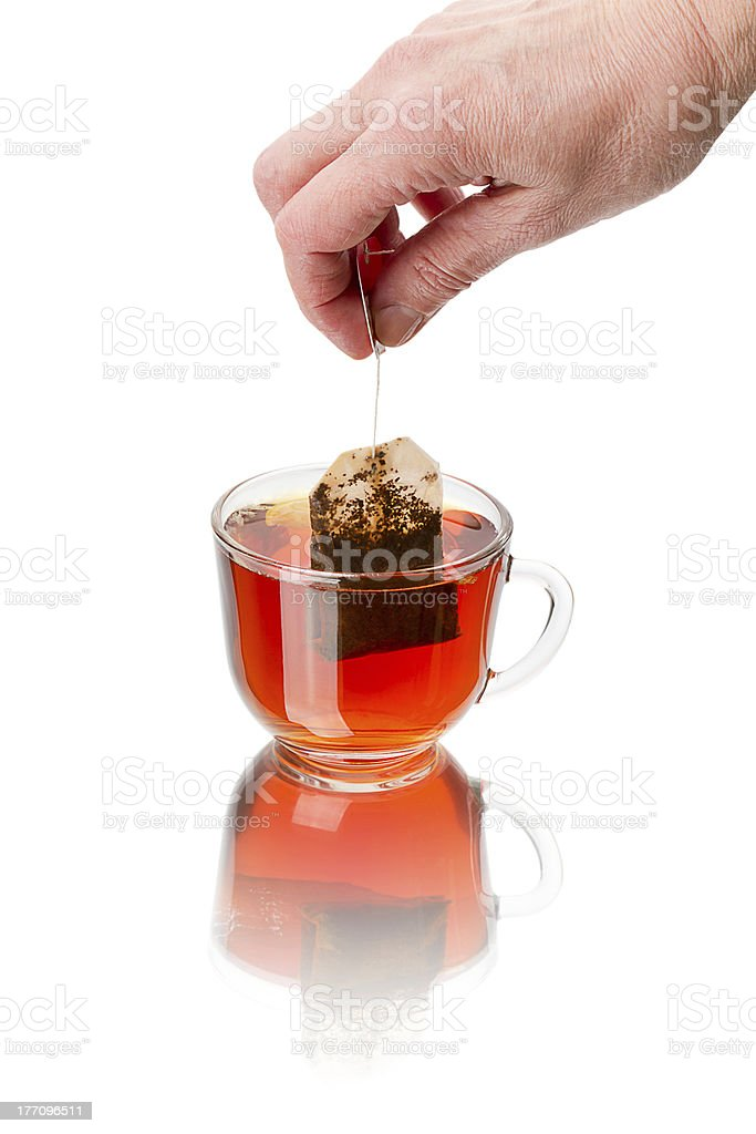Teabag and cup of hot tea royalty-free stock photo