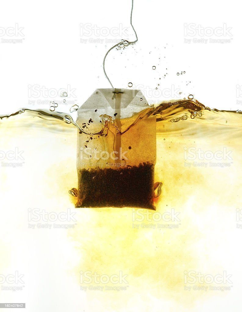 Teabag in hot water stock photo