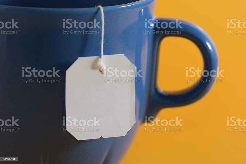 teabag label hanging from a mug stock photo