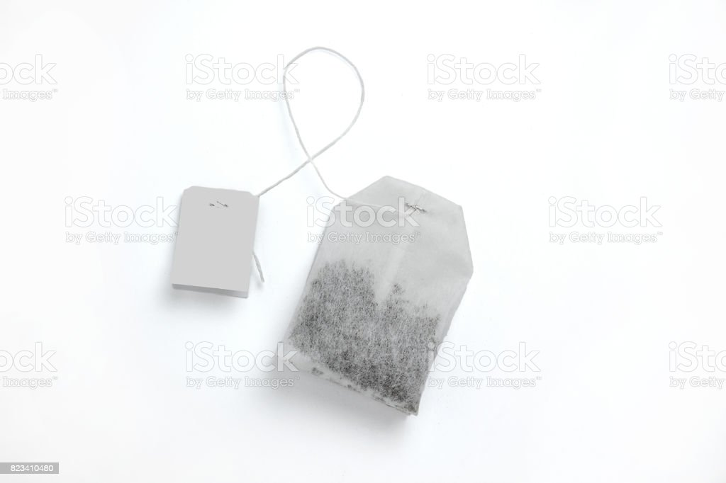 Teabag with grey label. Top view. Isolated on a white. mockup - foto stock