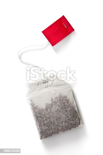 Finest tea in bag with empty red label and shadow isolated on white background.