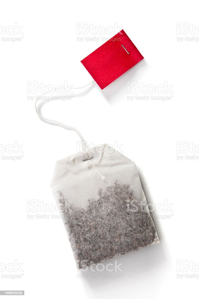 Teabag with red label isolated on white stock photo