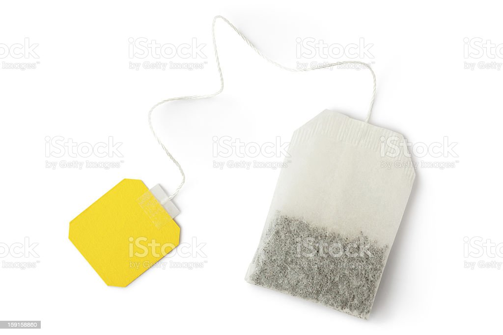 Teabag with yellow label. Top view. stock photo