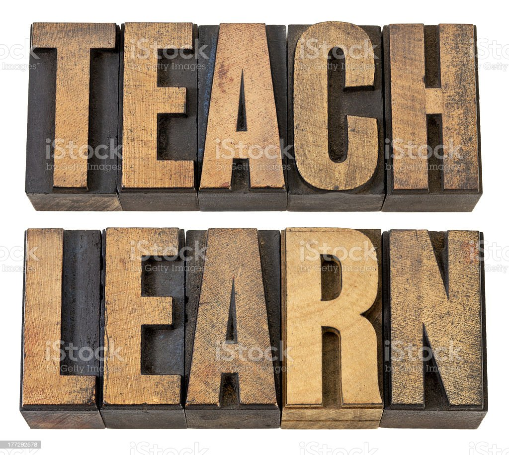 teach. learn - words in wood type royalty-free stock photo