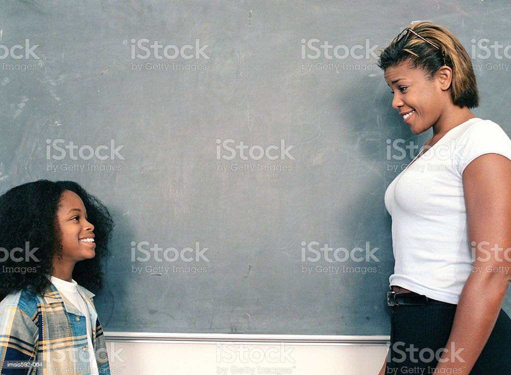 Teacher and boy in classroom royalty-free stock photo