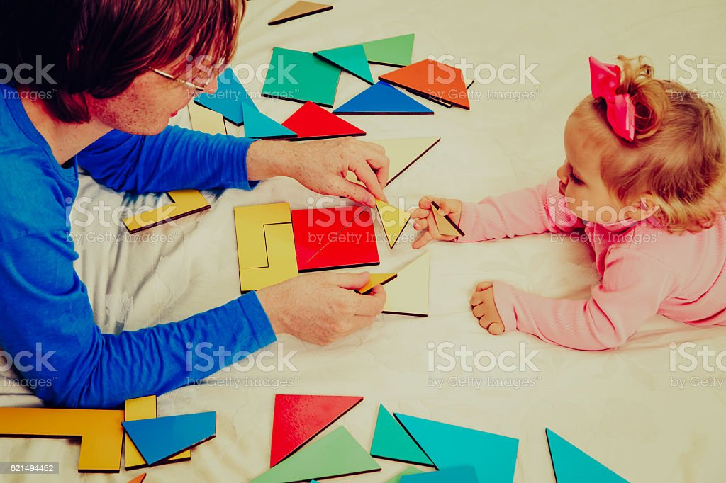 teacher and child playing with geometric shapes, early learning foto stock royalty-free