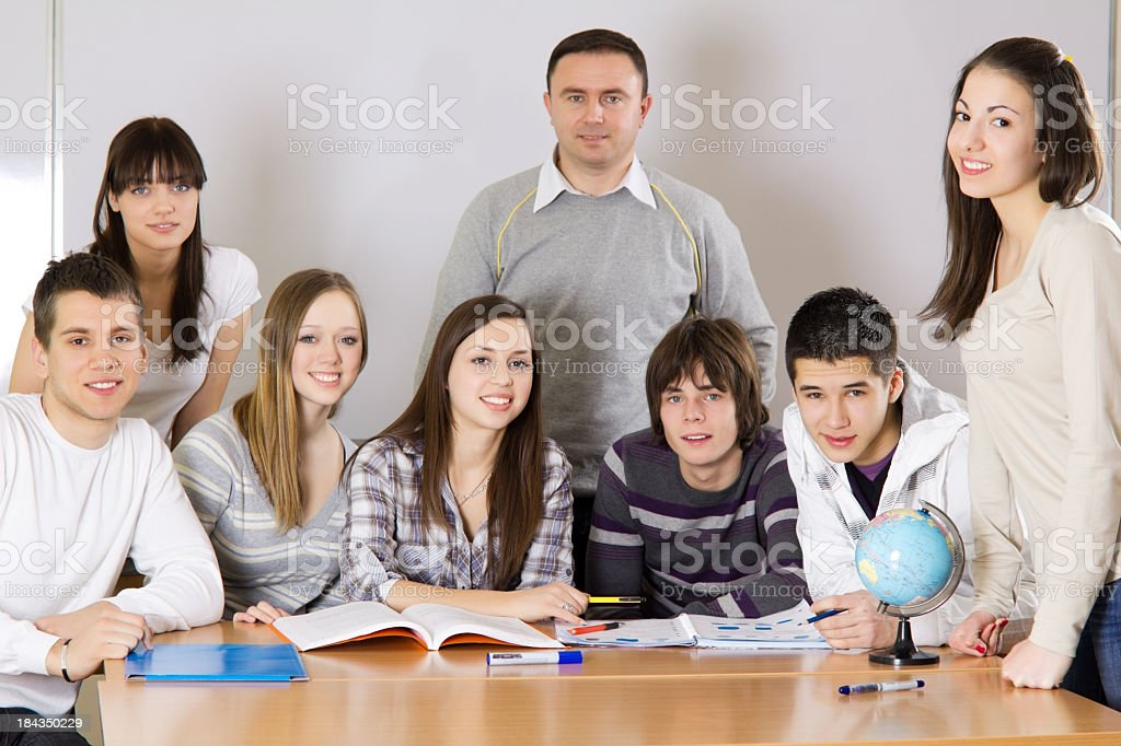 Teacher and high school students in classroom. royalty-free stock photo