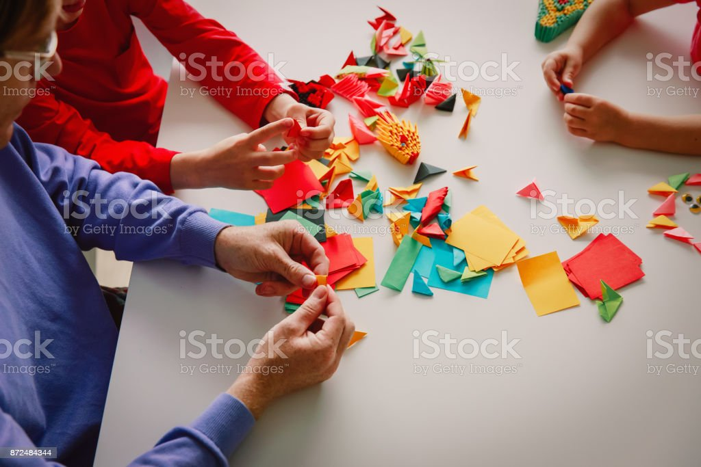 Teacher And Kids Making Origami Crafts With Paper Stock Photo More