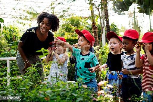istock Teacher and kids school learning ecology gardening 671254038
