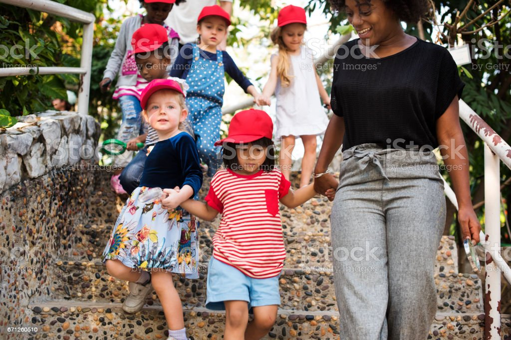 Teacher and kids school learning ecology gardening stock photo