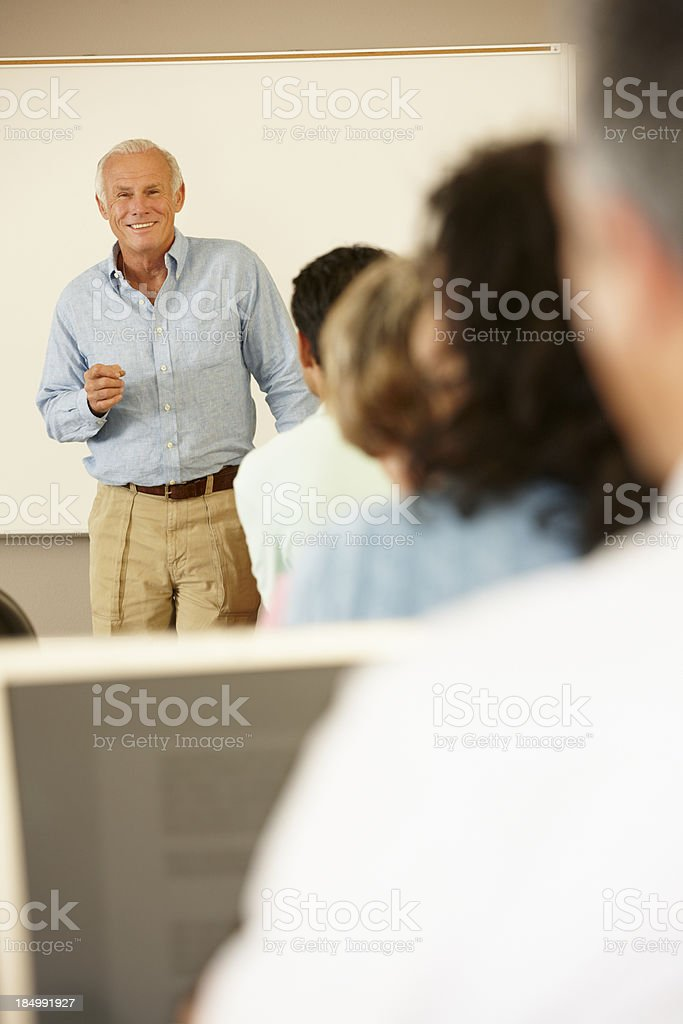Teacher and mature students in class royalty-free stock photo
