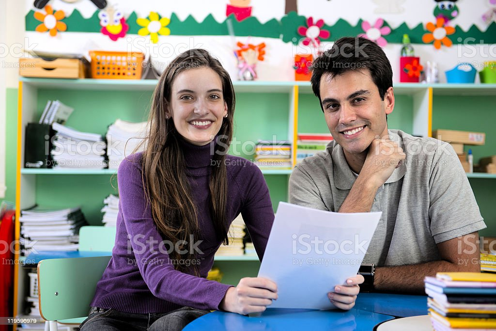 Teacher and parent meeting in school classroom royalty-free stock photo