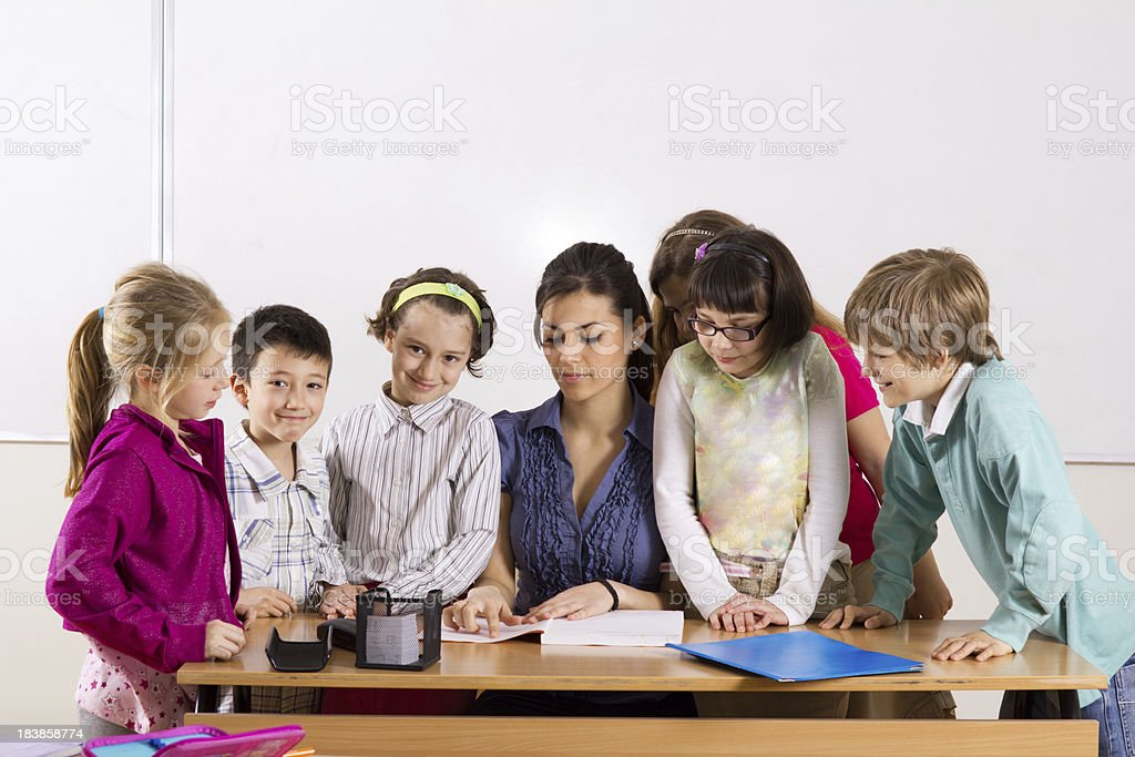 Teacher and primary school pupils  in classroom. royalty-free stock photo
