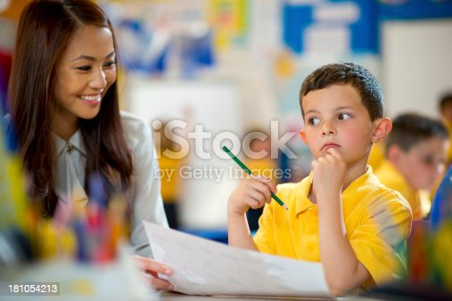 istock teacher and pupil 181054213