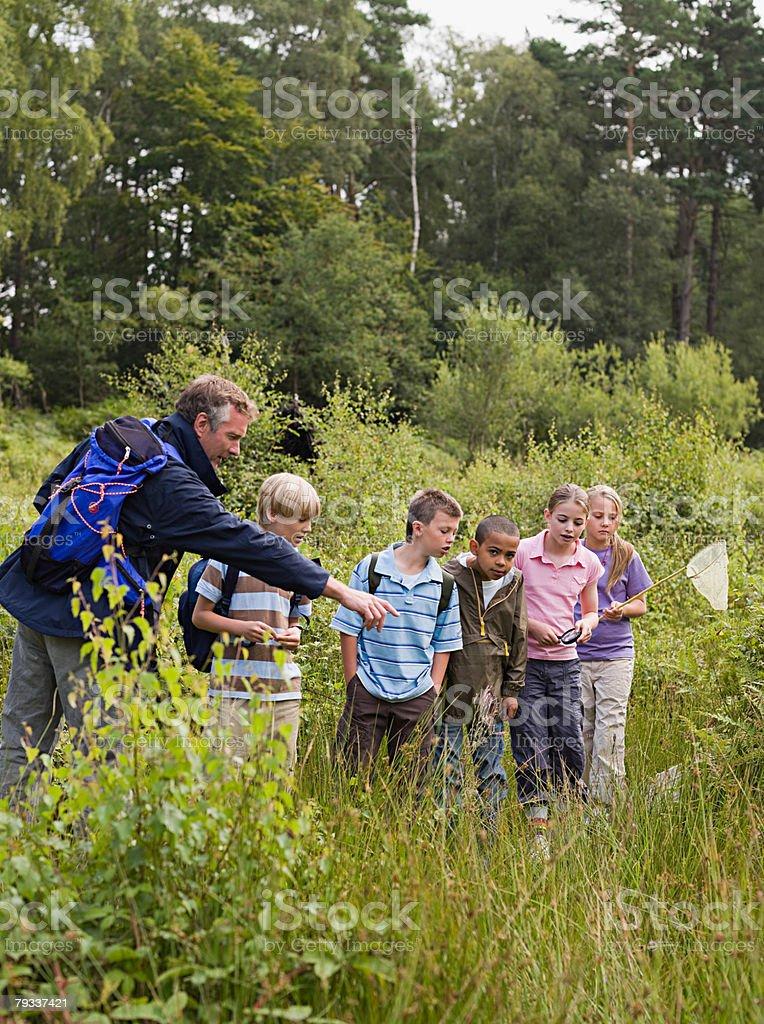 Teacher and pupils at nature reserve 免版稅 stock photo